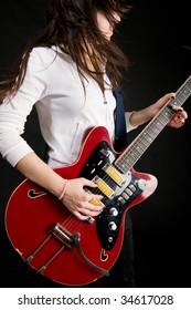 Girl playing electro guitar