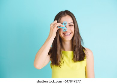 Girl playing with a fidget spinner