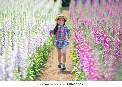 Girl playing in the flower field