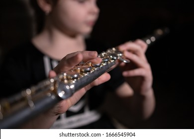 girl playing the flute, macro photo