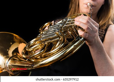 Girl playing the french horn
