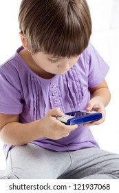 Girl playing a game console