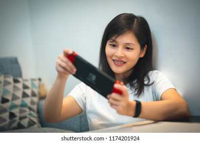 Girl playing Game at home