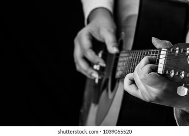 A girl playing the guitar