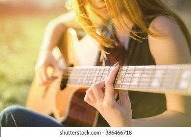 Girl playing the guitar. Fragment