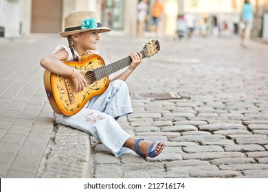 Girl playing guitar on the street