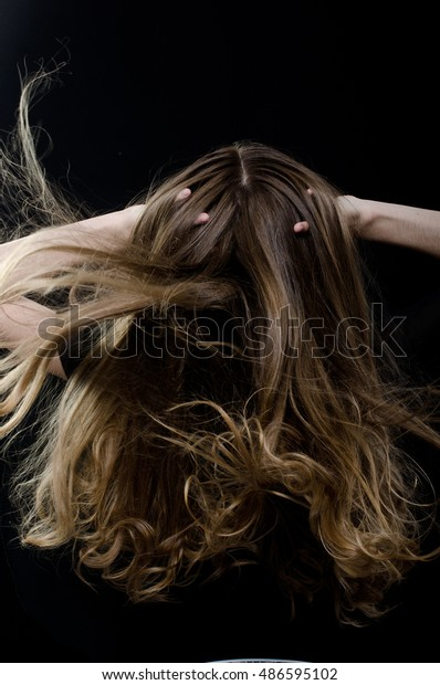 girl playing with hair