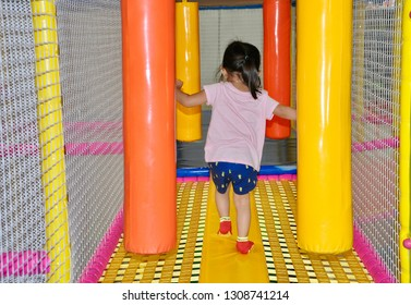 Girl playing in an indoor playground