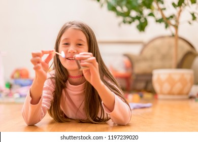 Girl playing with matches. Dangerous situation at home. A small child plays with matches, a fire, a fire flares up, danger, child and matches, lucifer match