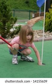 Girl playing miniature golf