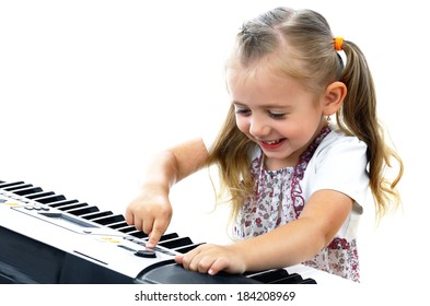 Girl playing a musical synthesizer