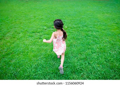 Girl playing on the lawn