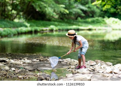 Girl playing on the river