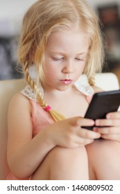 girl playing on smartphone of watching video