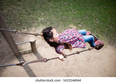 Girl playing on the swing