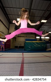 Girl playing on trampoline