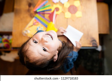 Girl playing with origami