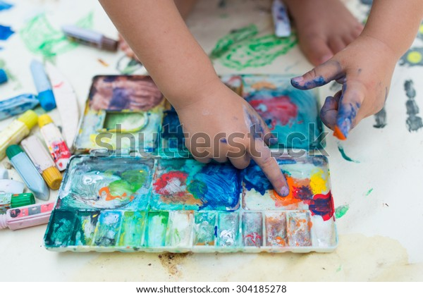 Girl playing in the paint