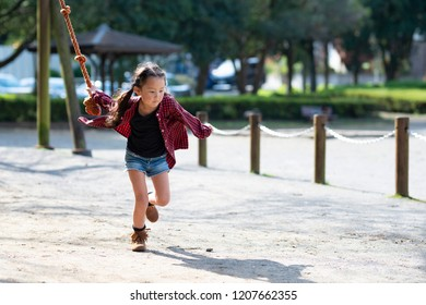 Girl playing in the park