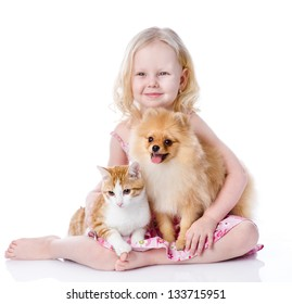 girl playing with pets - dog and cat. looking away. isolated on white background