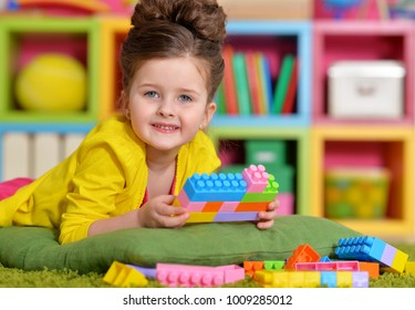 girl playing with plastic blocks