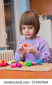 Girl playing with play dough - plasticine