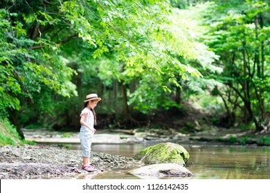 Girl playing in the river