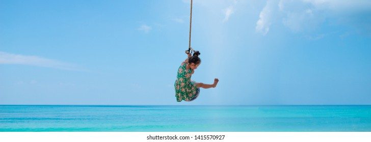 Girl playing with rope in the sea