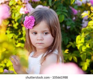 Girl playing in rose garden