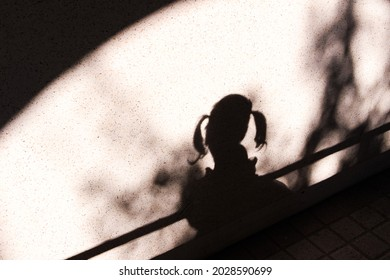 The girl is playing shadow.