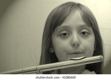 Girl Playing Silver Flute
