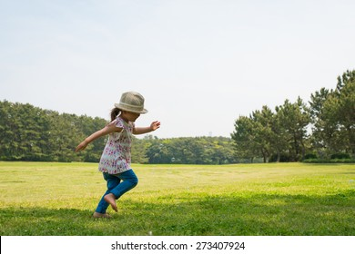 girl playing with soap bubbles