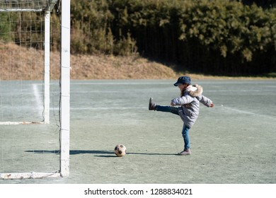 Girl playing with soccer ball