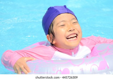 Girl playing in the swimming pool
