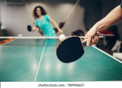 Girl playing table tennis.