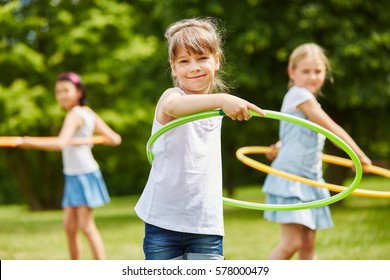 Girl playing with tire for movement training in kindergarden