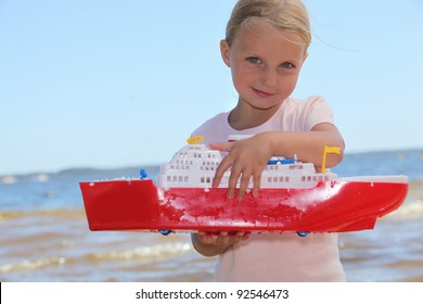 Girl playing with toy boat