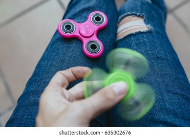Girl playing with two Hand Spinner