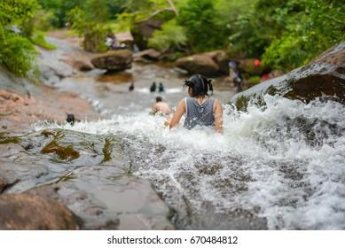 Girl playing waterfall alone
