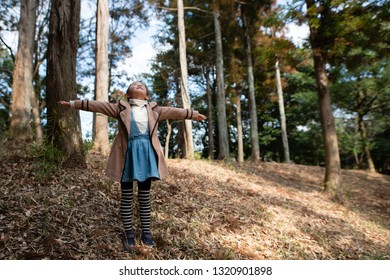Girl playing in the winter forest