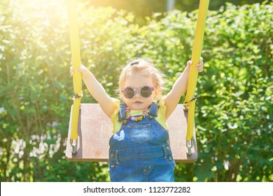 The girl plays cheerfully and happily on the playground.