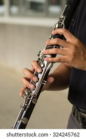 a girl plays a clarinet