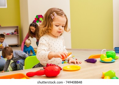 Girl plays with fruits