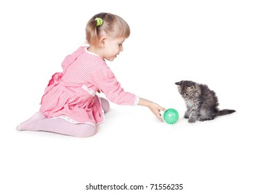 The girl plays with a kitten, an interior, white background