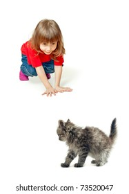 The girl plays with a kitten,white background