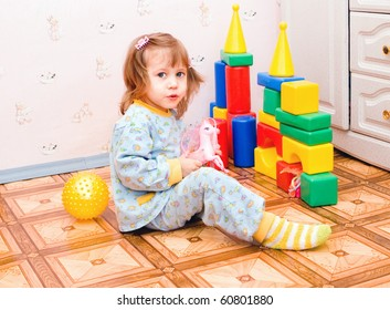 The girl plays with toys