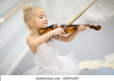 the girl plays a violin