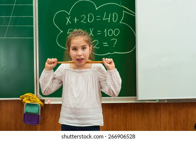 girl with a pointer in the classroom