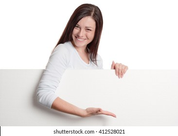 Girl pointing with hand on a huge blank white sheet of paper