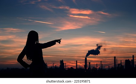 girl pointing to the smoke of factories